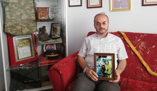 ŞEHİT FOTOĞRAFINDA YÜREK BURKAN DETAY
